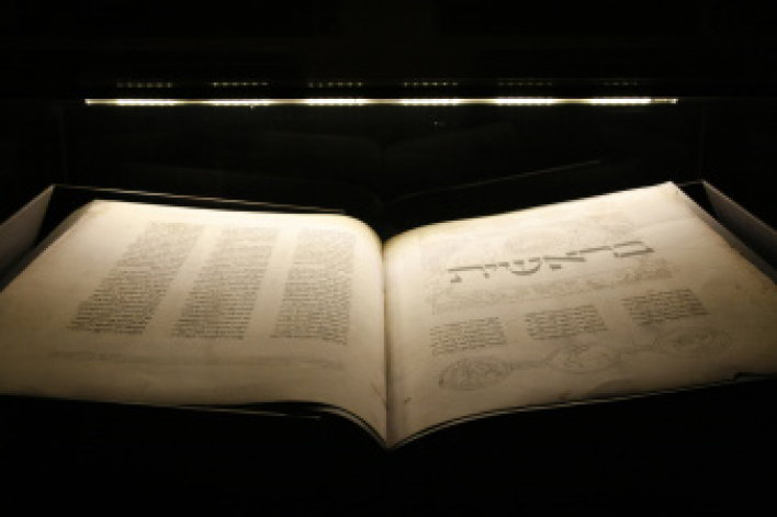Large Hebrew Bible, opened on the pages of the First book of Moses.