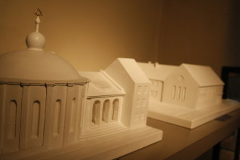 Two plaster models, one showing a domed structure, the other one a plain functional building