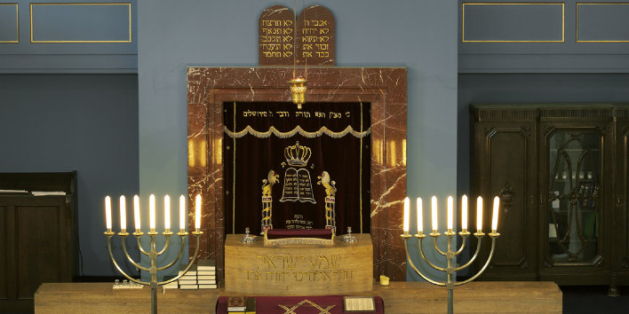 Torah shrine in the New Synagogue with plate of the Ten Commandments in Hebrew and two seven-branched  candelabra