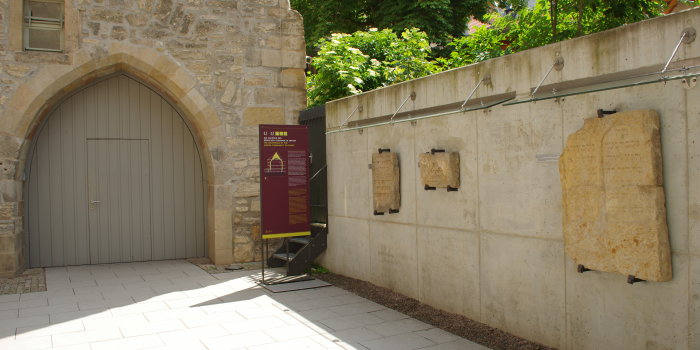 In the courtyard of the Old Synagogue, three medieval gravestones are on display.