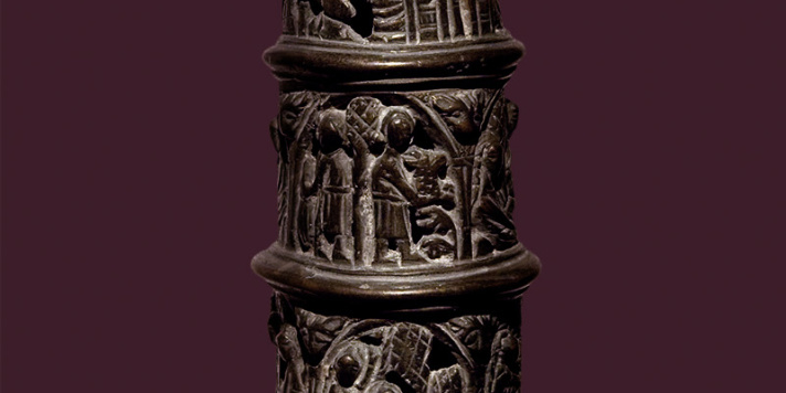 Bronze lamp with a slim, tall shaft decorated with motives from the Old Testament..